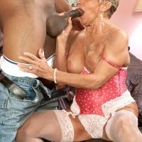 Bosomy stocking and lingerie clad Seventy plus grannie Sandra Ann giving giant black boner a oral job