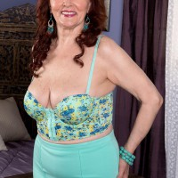 Busty ginger-haired MILF over 60 Katherine Merlot providing large cock tit job in nylons