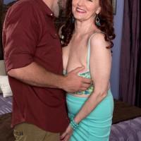 Busty ginger-haired MILF over 60 Katherine Merlot providing large cock tit job in nylons