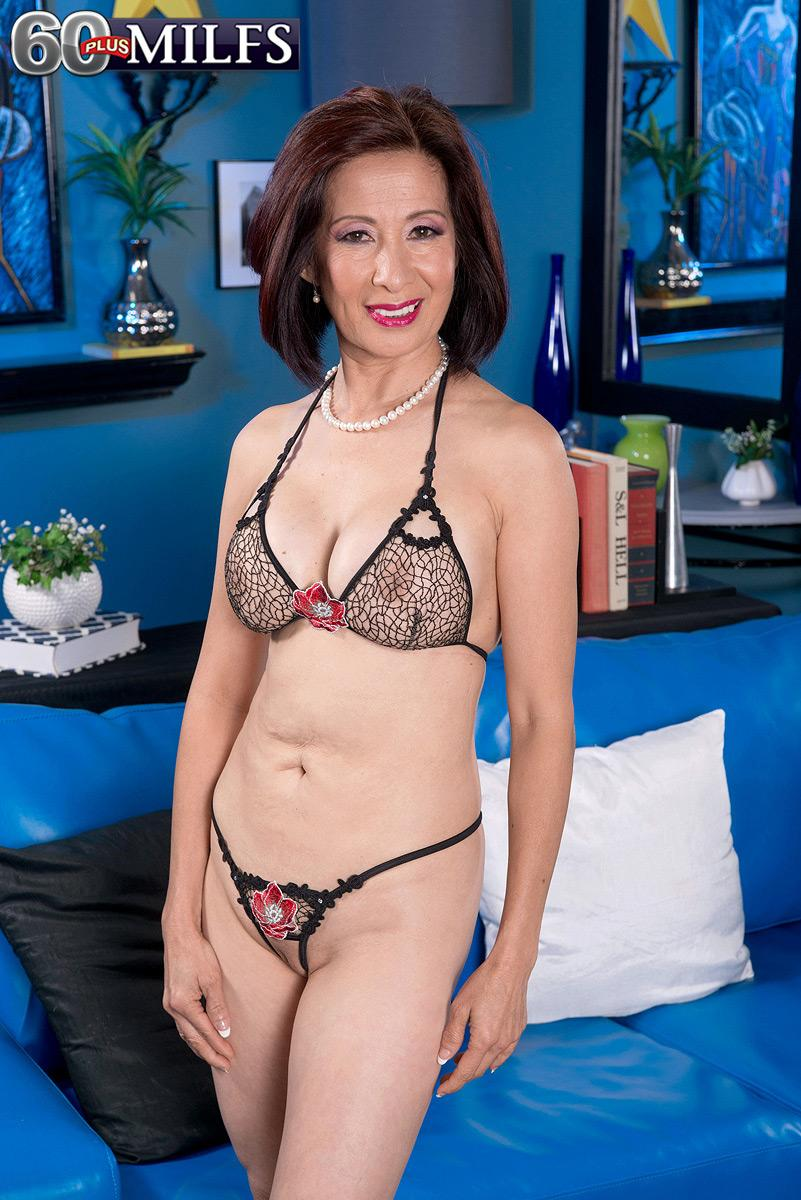 Chinese granny Kim Anh is undressed down to lingerie before exposing massive experienced breasts
