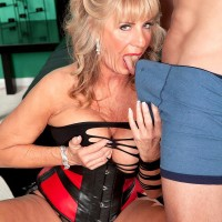 Gorgeous 60 plus MILF Silva Foxx seduces a junior man by showcasing her breasts in a denim miniskirt