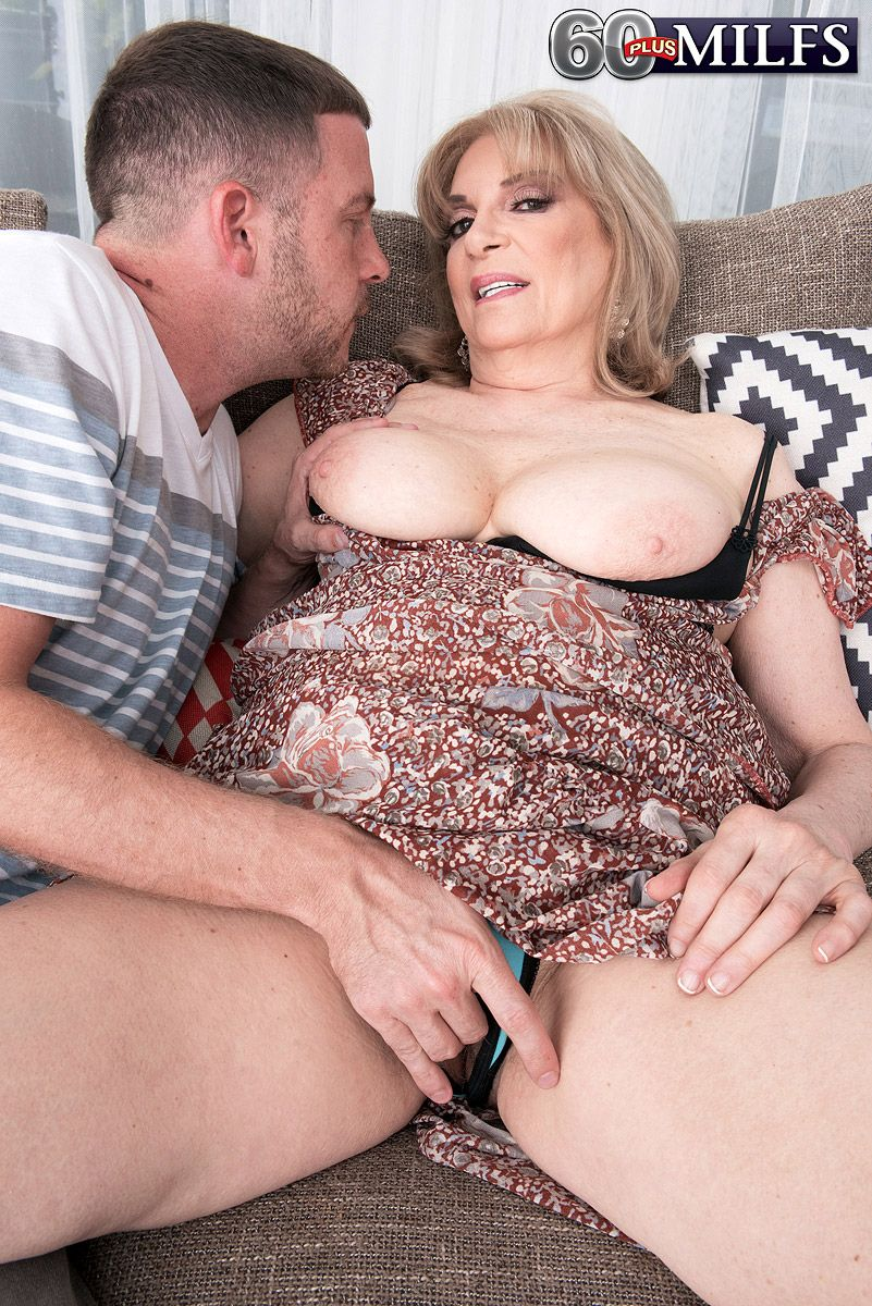 Mature MILF Crystal King has her big tits sucked on by a much younger man