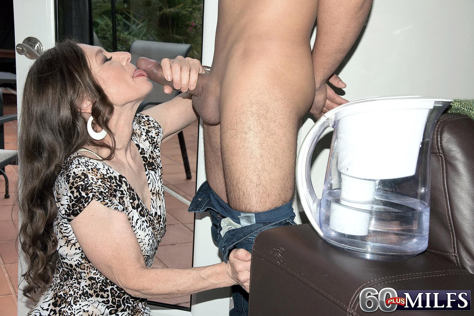 Dressed grandma Mona seducing junior guy by giving his huge cock fellatio