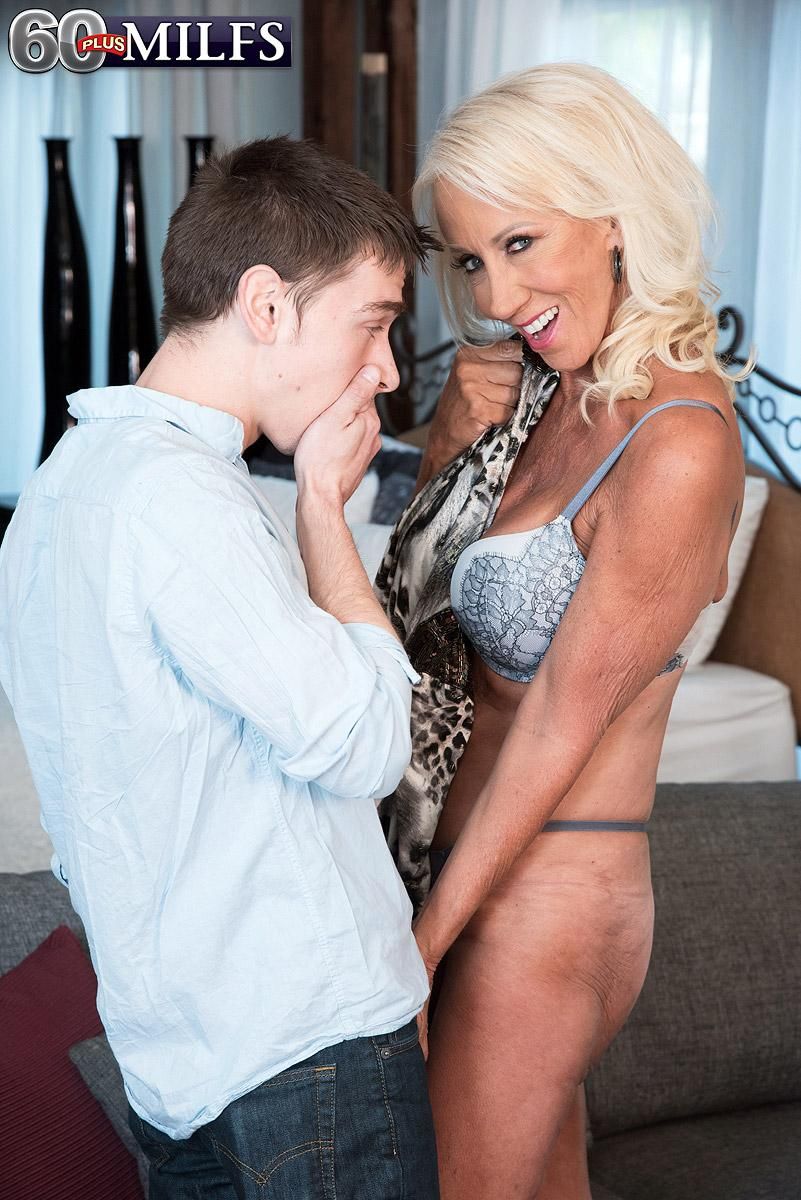 Enticing over sixty MILF Madison Milstar tempts a younger boy in her bra and panties