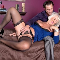 Fully clothed sixty plus MILF Jeannie Lou baring large experienced tits in crotchless bloomers