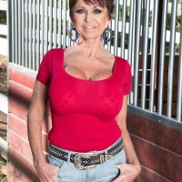 Hot older woman Gina Milano seduces the stable hand in denim shorts and boots