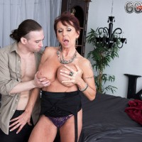 Busty mature pornstar Rita Daniels seducing cowboy in lingerie and stockings