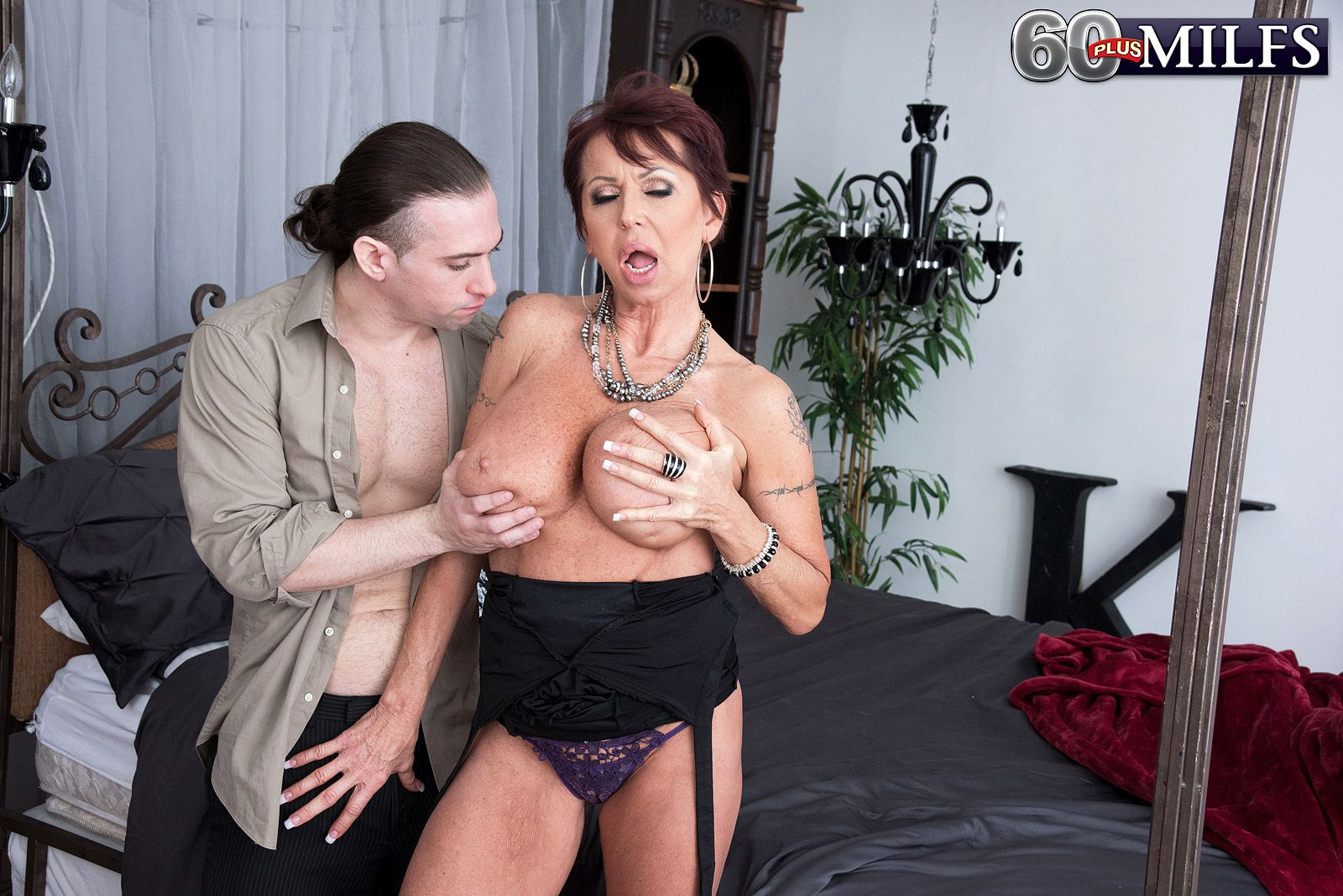 Hot 60 plus MILF Gina Milano seduces younger man with a naughty panty flash