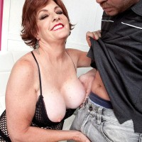 Ginger-haired grandmother Gabriella LaMay extracting monster-sized knockers and nipples from bodystocking