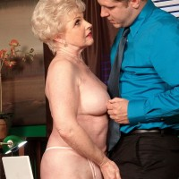 Grannie XXX video starlet Jewel seducing sex from younger boy in office adorned tan tights