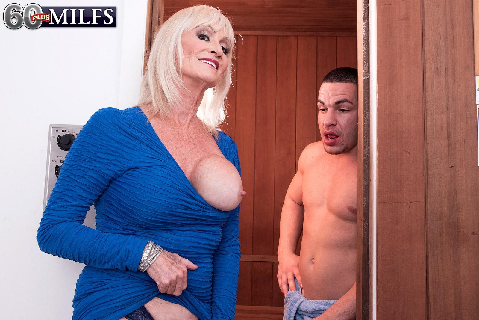 Mischievous 60 plus MILF Leah L'Amour seduces a younger stud in the sauna before delivering a fellatio