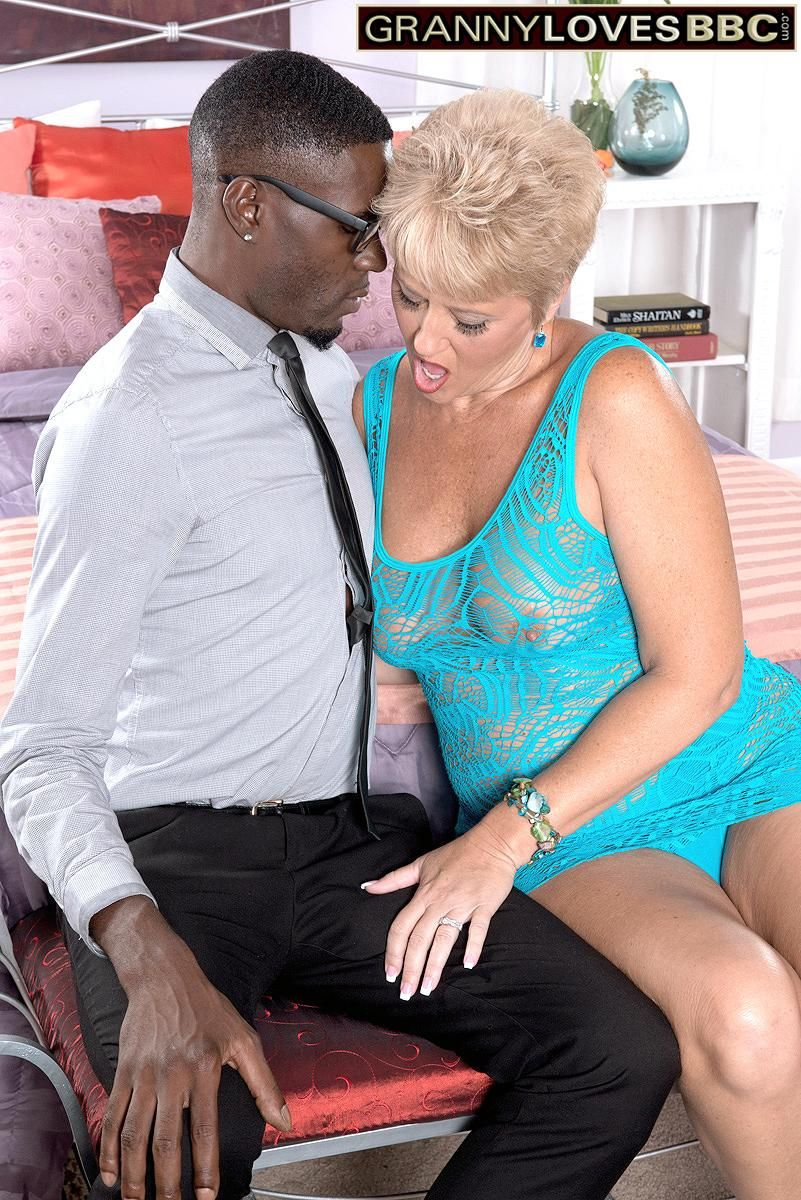 Filthy grandma Tracy Munches entices a younger black stud by displaying her huge all-natural titties