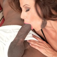 Hot granny Mimi Moore gives a big black dick a blowjob in sexy lingerie and stockings