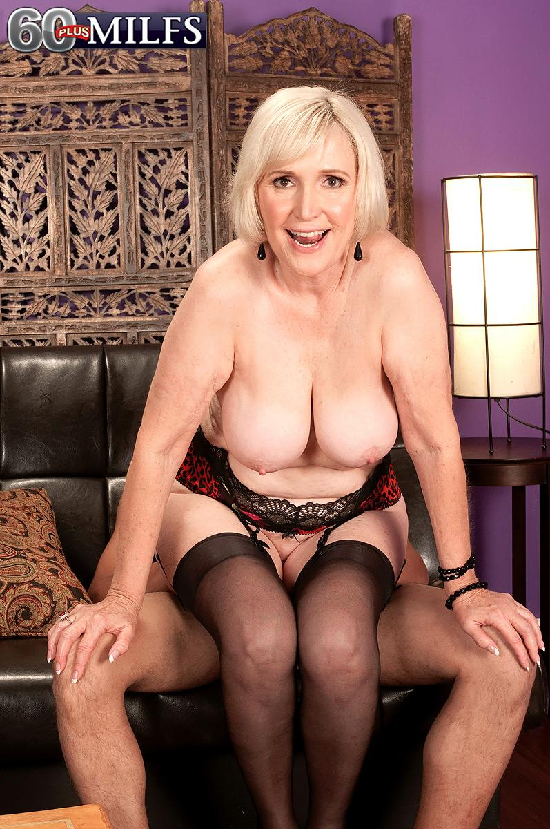 Huge-boobed mature adult film star Lola Lee providing BJ in hosiery and lingerie