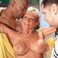 Huge-boobed over 70 grannie Sandra Ann stripped for bi-racial MMF three way sex