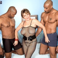 Huge-chested 60 plus MILF Bea Cummins jacking BBC in multiracial threesome sex fest