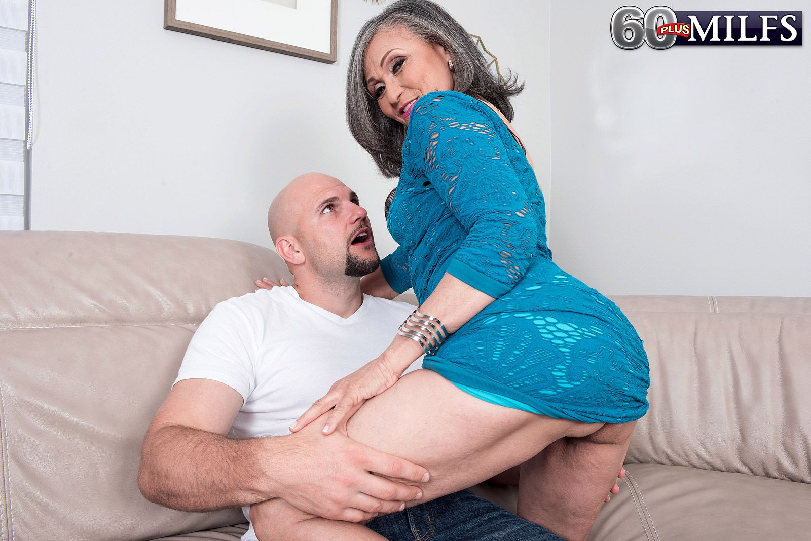 Mature lady Kokie Del Coco seduces a much younger man in a blue dress