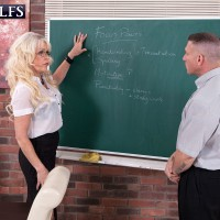 hot mature teacher Lady S seduces a younger man attired in a black skirt and glasses