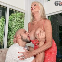 Mature blonde woman Leah L'Amour seduces a younger man with her big naturals