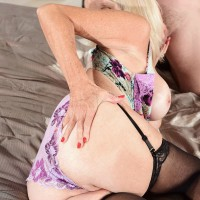 Hot blonde granny Leah L'Amour seduces  younger guy in lingerie and nylons