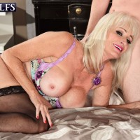 Huge-chested yellow-haired 60 plus MILF schoolteacher Angelique DuBois draining monster-sized dick in classroom