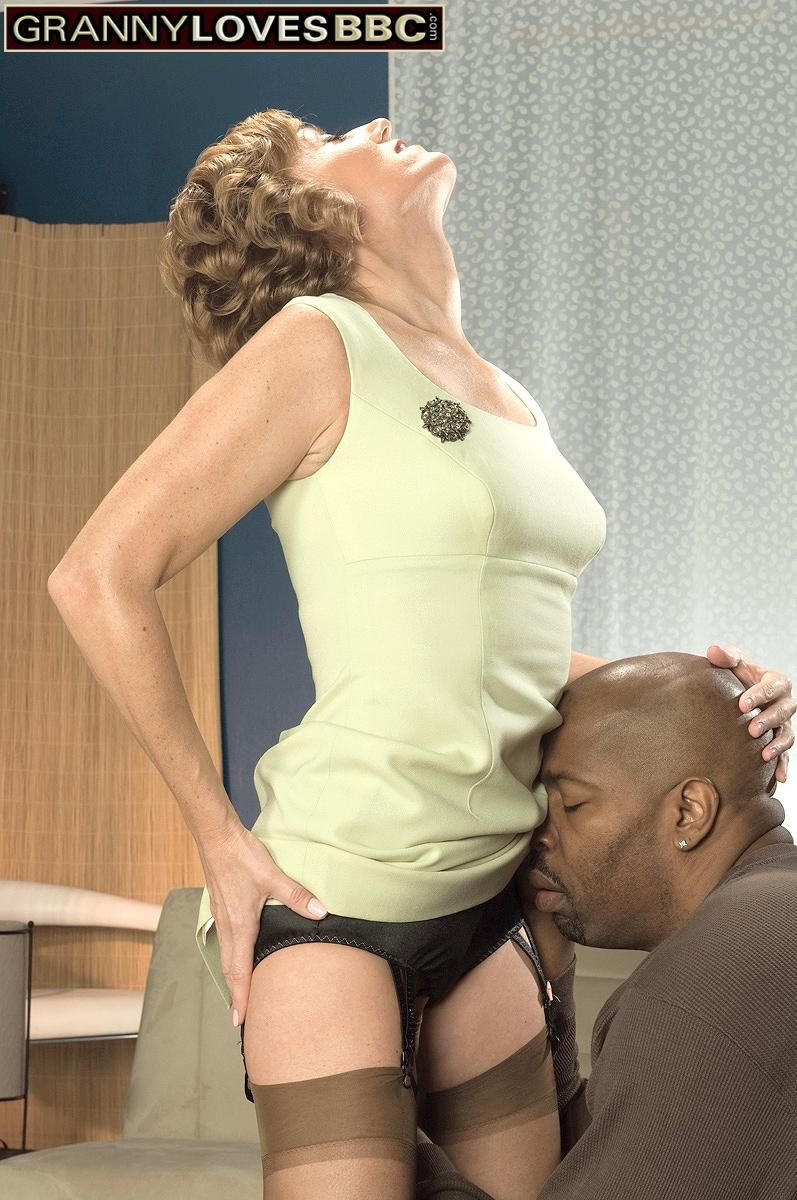 Tall granny Avalynne O'Brien tempts a black dude in hosiery and garters