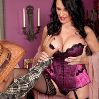 Lingerie and pantyhose wearing aged X-rated starlet Rita Daniels slurping gigantic prick with tongue