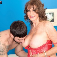 Lingerie attired dark haired grandma Jacqueline Jolie letting out monster-sized boobs for nipple gobbling