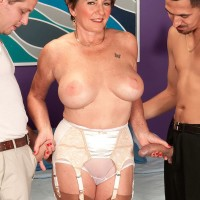 Lingerie clad over Sixty MILF Bea Cummins wanking off large cocks in MMF three-way