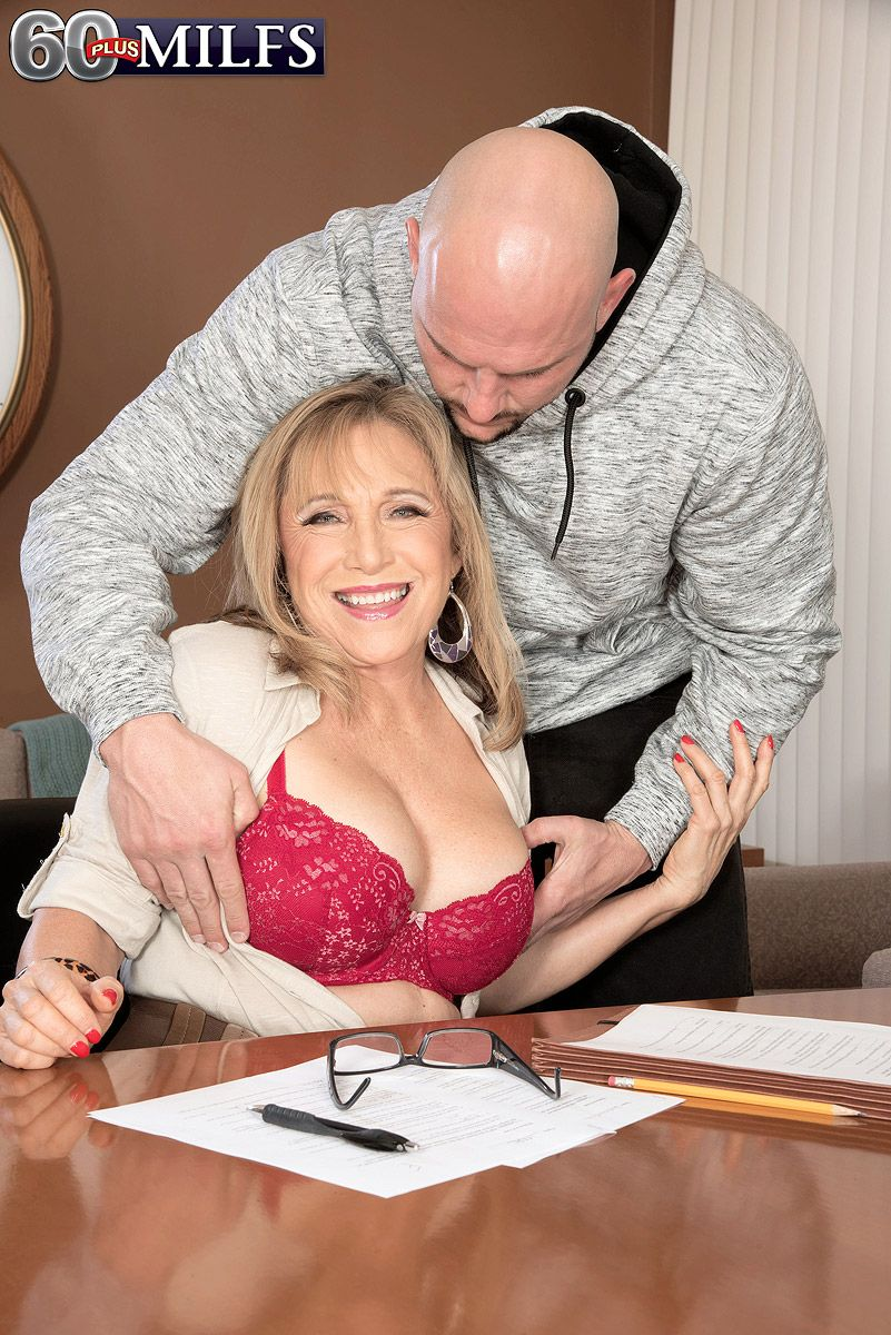 Mature business woman Luna Azul attracts the attention of a younger man