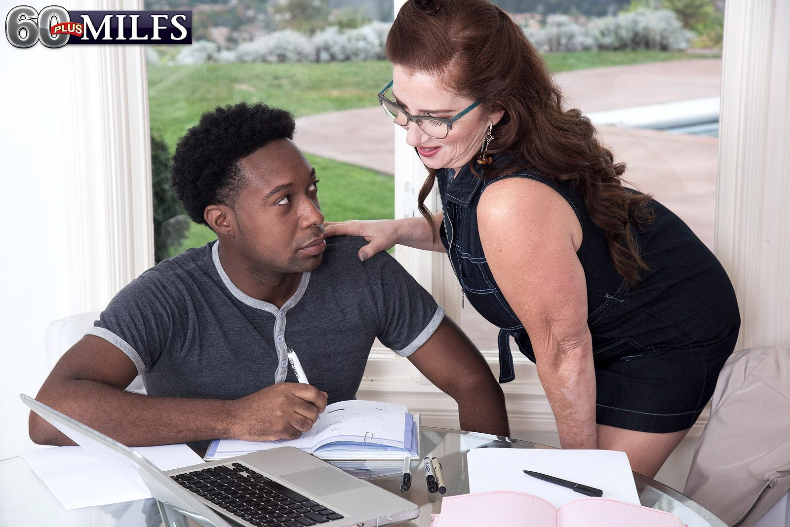 Over 60 MILF Maria Fawndeli seduces a younger black man in her home office