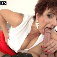 Mature redhead Jessica Hot gets banged doggystyle on a bed by her young lover