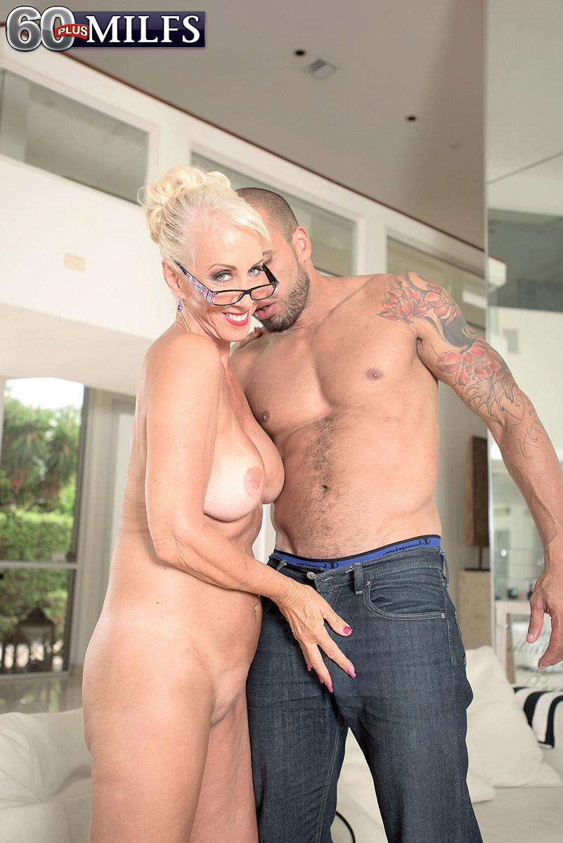 Mature blond XXX vid star Madison Milstar exposing big hooters and upskirt underwear