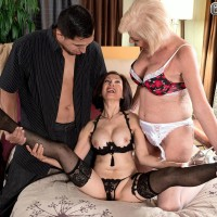 Mature lesbos Scarlet Andrews and Kim Anh having multiracial threesome sex