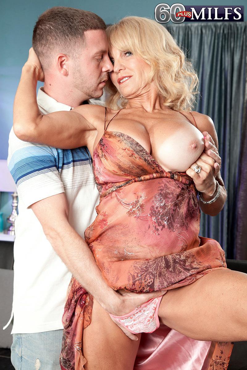 Mature sandy-haired stunner Cara Reid baring large grannie porno star boobs before sex