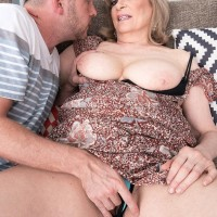 Mature woman Crystal King has her big boobs played with by a younger man