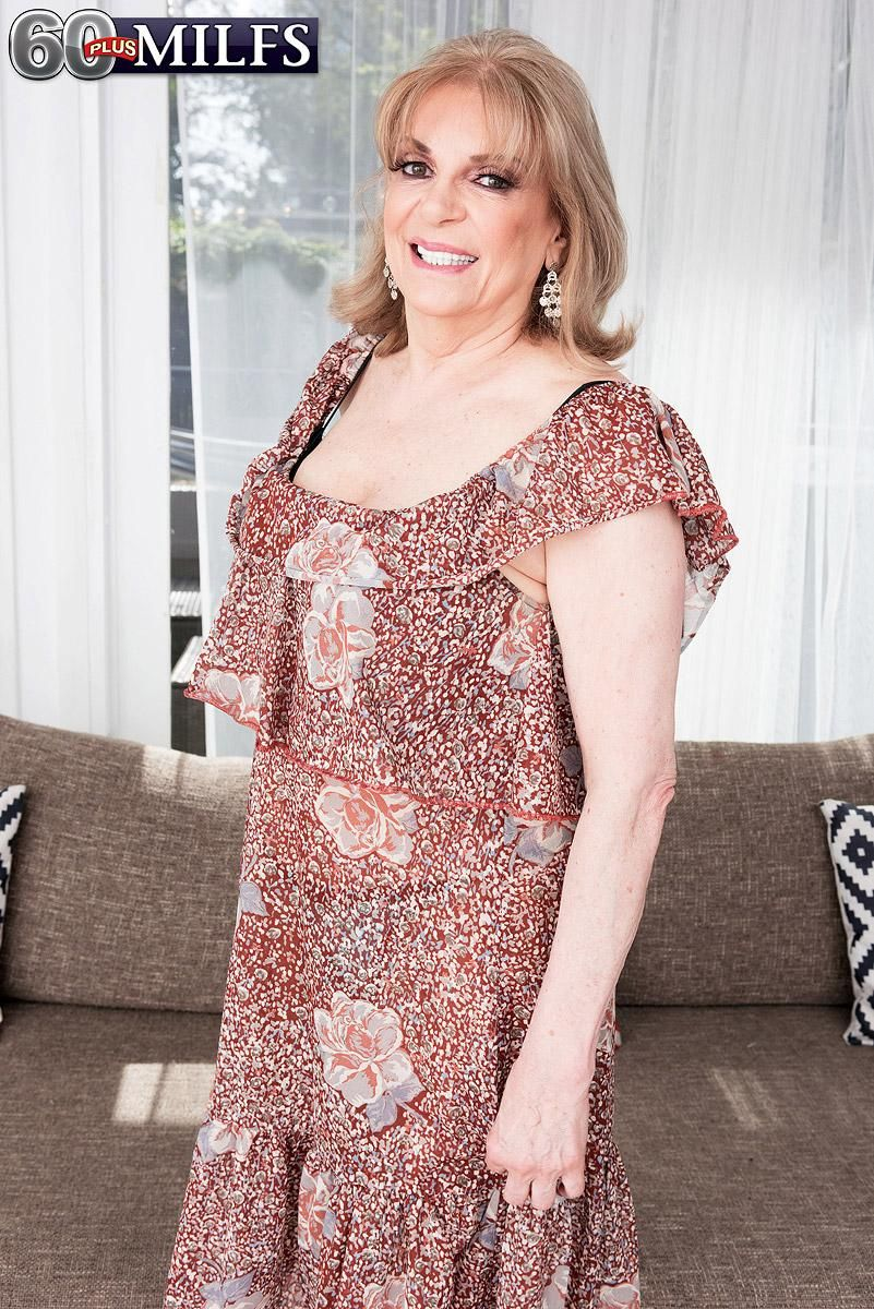 Aged dame Crystal King has her enormous melons toyed with by a younger stud