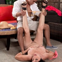 Over 50 MILF Raven Flight is freed from a pink dress by her younger Latino lover