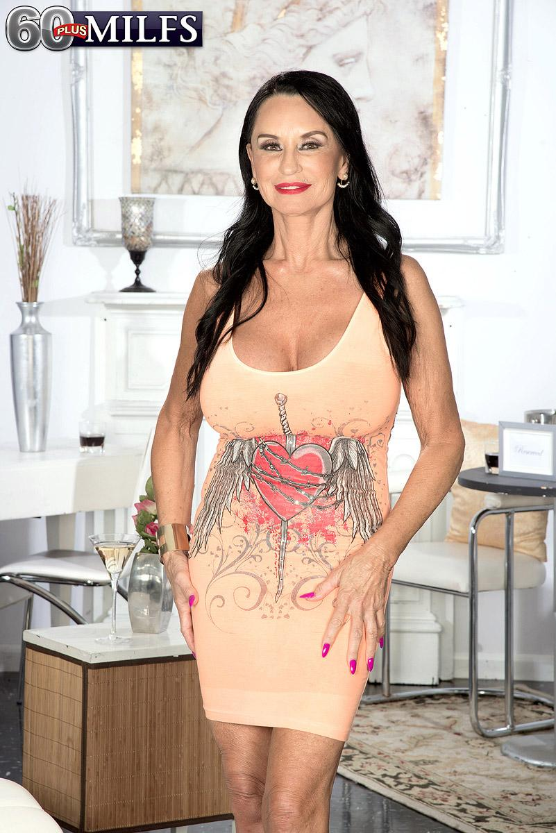 Over 60 brown-haired MILF Rita Daniels showing off fine legs and immense fun bags - 60MILFs.com
