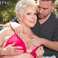 Over 60 grannie Jewel exposing huge breasts from bathing suit before doggy boinking