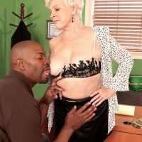 Over 60 MILF releasing big grandma melons before interracial sex in work environment with BIG EBONY DICK