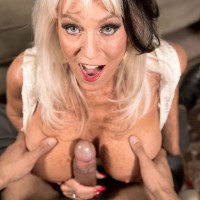 Over 60 MILF Sally D'Angelo freeing huge boobies before delivering large hard-on BJ