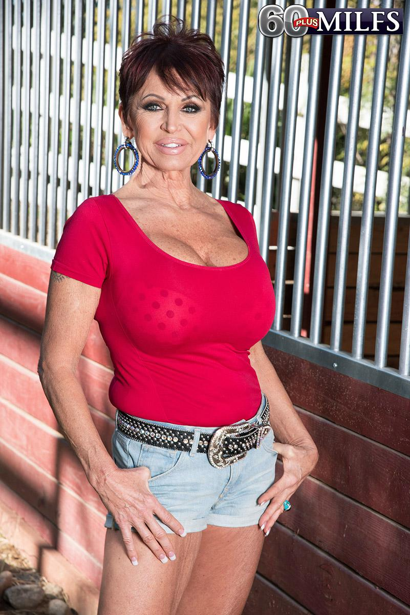 Over 60 woman Gina Milanos entices a young man with her huge funbags in denim cut-offs