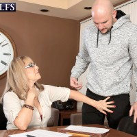 Over Sixty instructor Luna Azul entices a masculine student in her office place