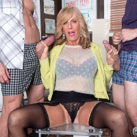 Over Sixty redhead MILF Phoenix Skye blowing giant knobs in MMF three way