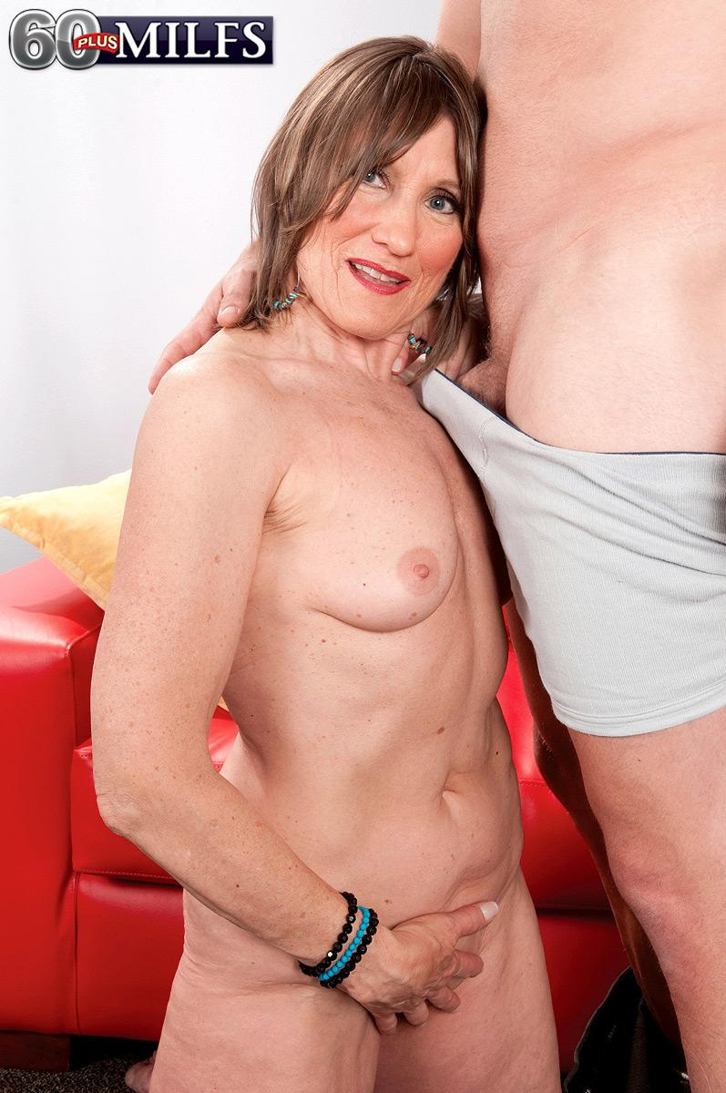 Pantyhose clad grandma Donna Davidson disrobed for sex by junior man