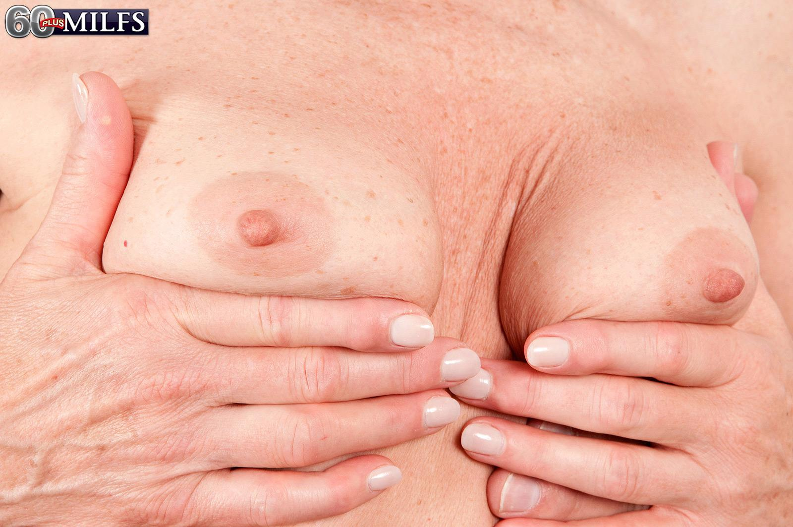Pantyhose clad grandma Donna Davidson disrobed for sex by junior man