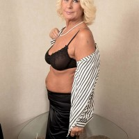 Platinum-blonde grandma Regi letting flappy free from bra before lube massage from masseuse