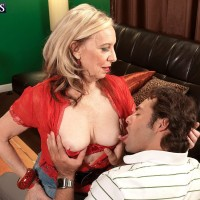 Platinum-blonde MILF over 60 Miranda Torri unveiling immense natural knockers and bare derriere