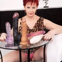 Redhead MILF over 60 Caroline Hamsel goes topless while sucking big dildos